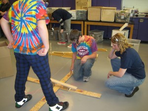 Katelynn Greer discussing engineering design challenges with a middle school Science Olympiad team during a spring 2011 competition.