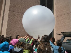 Girl Scouts help launch a weather balloon during NCAR's Girl Scout day.